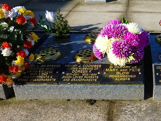 A Kerb Tablet in black granite with gold lettering